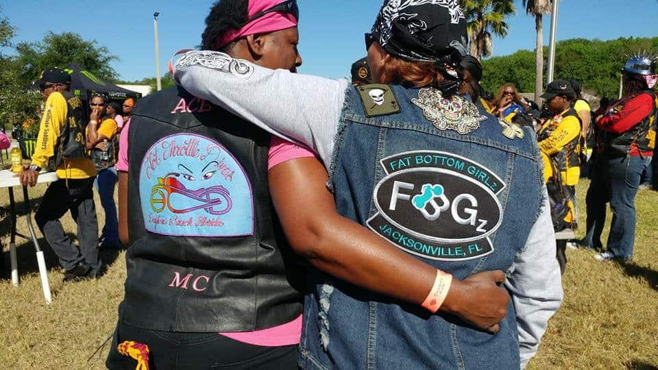 Two members of FBGz showing the patches on the back of their biker vests
