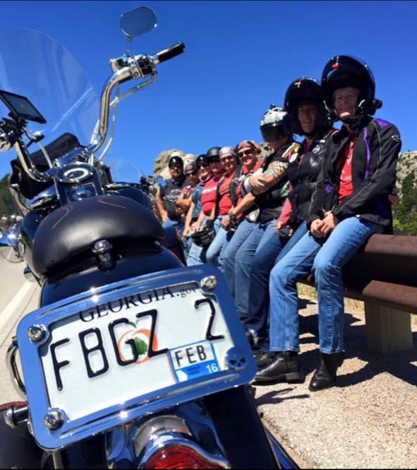 A group photo of some FBGz members with a bike in the foreground