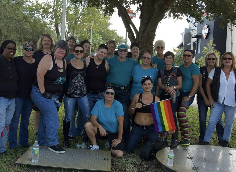 A group photo of FBGz members with the gay pride flag
